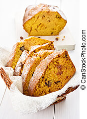 Sliced pumpkin loaf with nuts, cinnamon and raisin