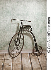 Historical bicycle by the wall