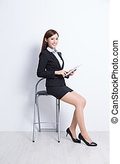 business woman sit with digital tablet pc computer with...