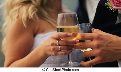 wedding couple drinking foaming champagne close up