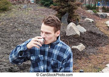 guy boy in town drinking hot tea