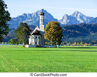 Grand church with large mountain background - St Coloman...