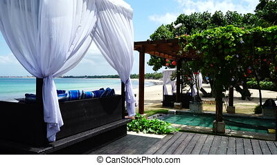 Gazebo and pool on the beach. - Wind is blowing on the...