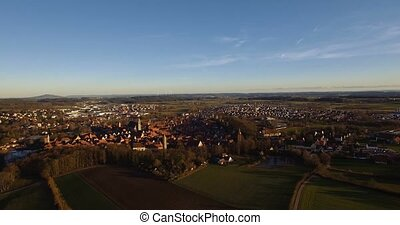 4K Aerial, Flight over landscape around small village in...