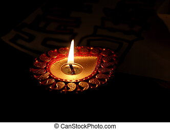 Indian Diya - Beautifully lit Indian colourful diya which is...