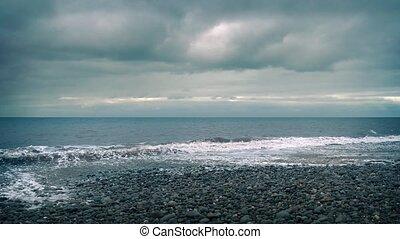 Beach Shore Cloudy - Barren windswept beach with storm...