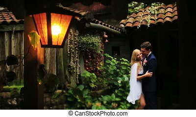 Happy wedding couple in the wooden alcove on woods of Montenegro, Budva