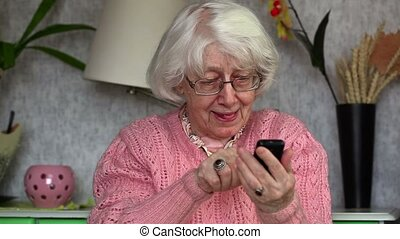 Happy old woman with cell phone