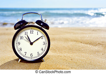 adjusting forward the clock for the summer time - closeup of...