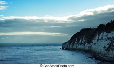 Coast Seascape - Cliffs and ocean with the sun rising behind...