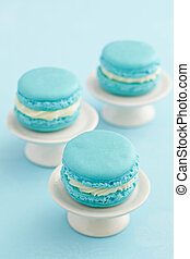 Macarons on cake stand - Three turquoise macarons with...