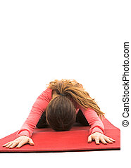 Childs pose - Woman relaxing during yoga in child's pose....