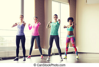 group of women working out in gym - fitness, sport,...