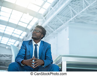 The dark-skinned man - American young businessman in office
