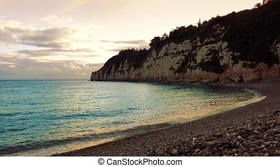 Sea Cove At Sunset - Cove with cliffs and beach in the...