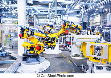 robots in a car plant - robotic arms in a car plant