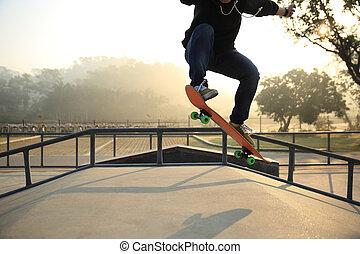 silhouette of skateboarder skateboarding at  skatepark