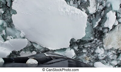 Bow of Icebreaker Ship breaks ice. Top view. - Bow of...