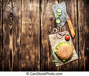 Cooked Burger with vegetables, cheese and meat On wooden...