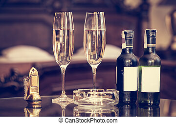Champagne, glasses, antique keys. Luxury hotel apartment, room service