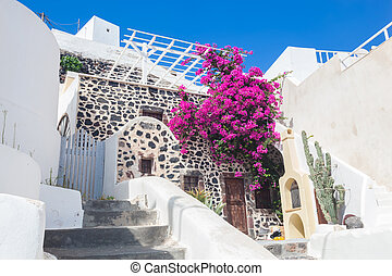 Traditional Greek whitewashed stone house, Santorini island,...