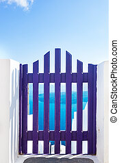 Small blue fence gate in Oia on Santorini island, Greece...