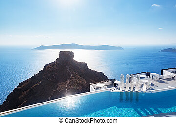 Swimming pool with a view on Caldera over Aegean sea,...