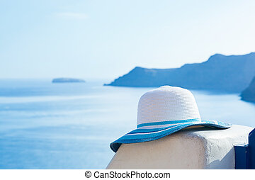 Sun hat on white stone wall on Santorini island, Greece....