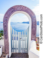 Traditional fence gate in Oia on Santorini island, Greece...