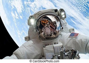 astronaut in space - astronaut floating in space with the...