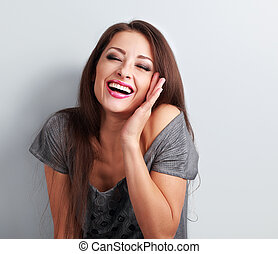 Laughing makeup trendy woman with wide open mouth and closed...