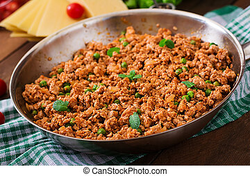 Minced meat in a frying pan for stuffing lasagna