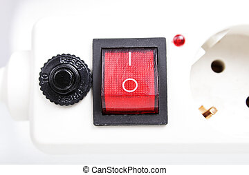 The switch with the socket and a safety lock