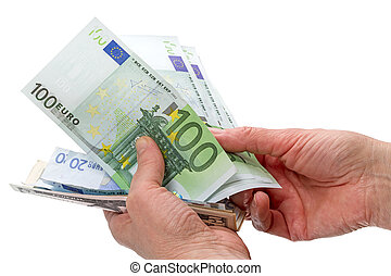 Euro and dollars in hands