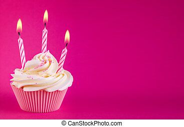 Birthday cupcake - Cupcake decorated with three pink candles