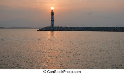 Lighthouse and rising sun above 4k - Lighthouset the sunrise...