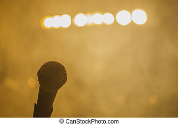 microphone on stage with bright headlights