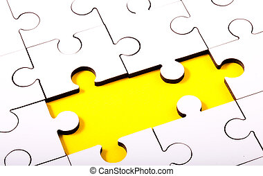 Jigsaw With Two Pieces Missing Showing Yellow Underlay