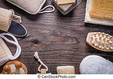 Assortment of bathing items on wooden board directly above