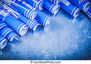 Blue engineering drawings on metallic background directly...