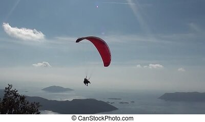 Parachute sliding in the sky - Parachute with two people...