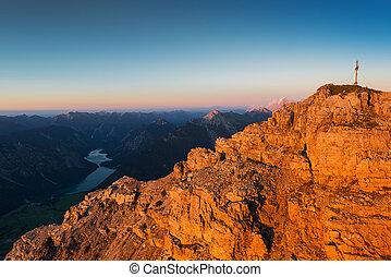 orange rough rocks of mountain at sunset light at fall