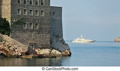 Ancient architecture with clear blue sea in Budva,...
