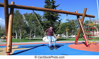 Children playing at the playground - Elementary aged...