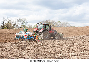 Farmer planting the spring crop with an agricultural planter