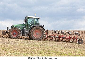 Ploughing a fallow field - Farmer ploughing a fallow field...