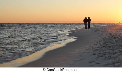Mature Couple Walk Beach