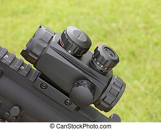 Scope - Low magnification scope mounted on a rifle with a...