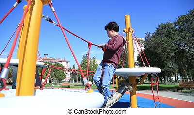 Children playing at the playground - Elementary aged child...