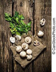 Parsley and fresh mushrooms On wooden background - Parsley...